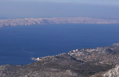 This is a peaceful village called Karlobag and the long island Pag in the distance