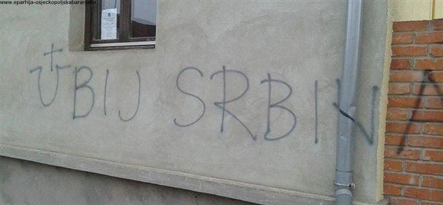https://jadovno.com/tl_files/ug_jadovno/img/preporucujemo/2014/Ustaski_grafiti_na_parohijskom_domu_SPC_u_Vinkovcima.jpg