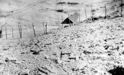 The Jewish Camp with the barracks and a small shed in the back. On the left we can see a stone road leading towards Baška Slana. On that road they were taken to their deaths, towards the sea or Velebit. (Italian photo, September 1941).