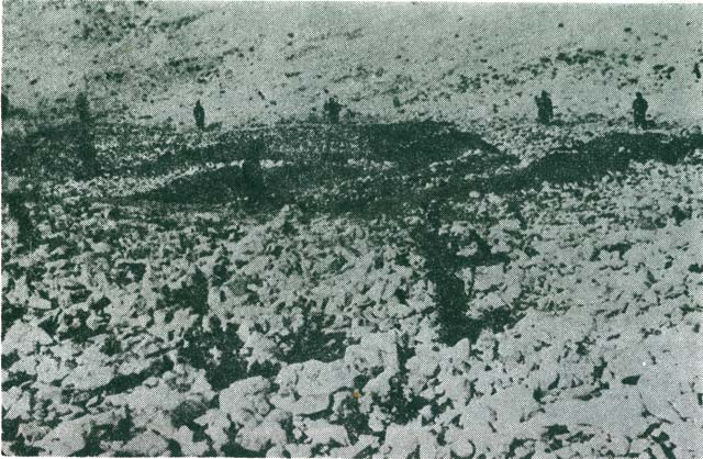 Graves of the murdered people. Italian soldiers around the graves (Italian photo 1941).